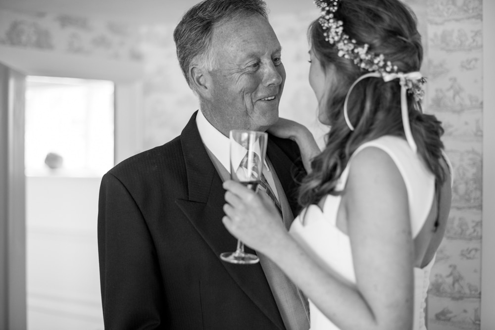 Father of bride seeing his daughter for the first time in her dress