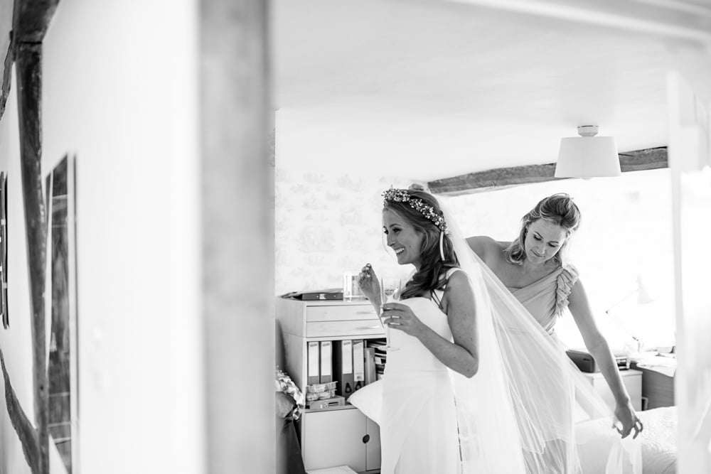 Bride getting ready with main of honour