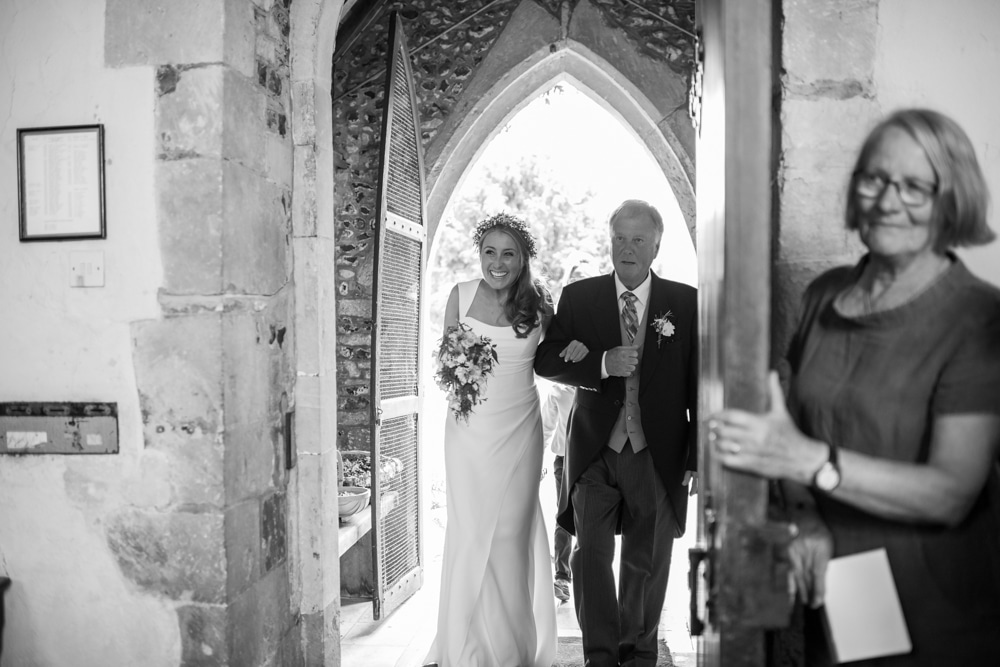Bride walking into the church with her father