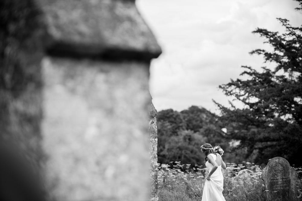 bride walking in churchyard