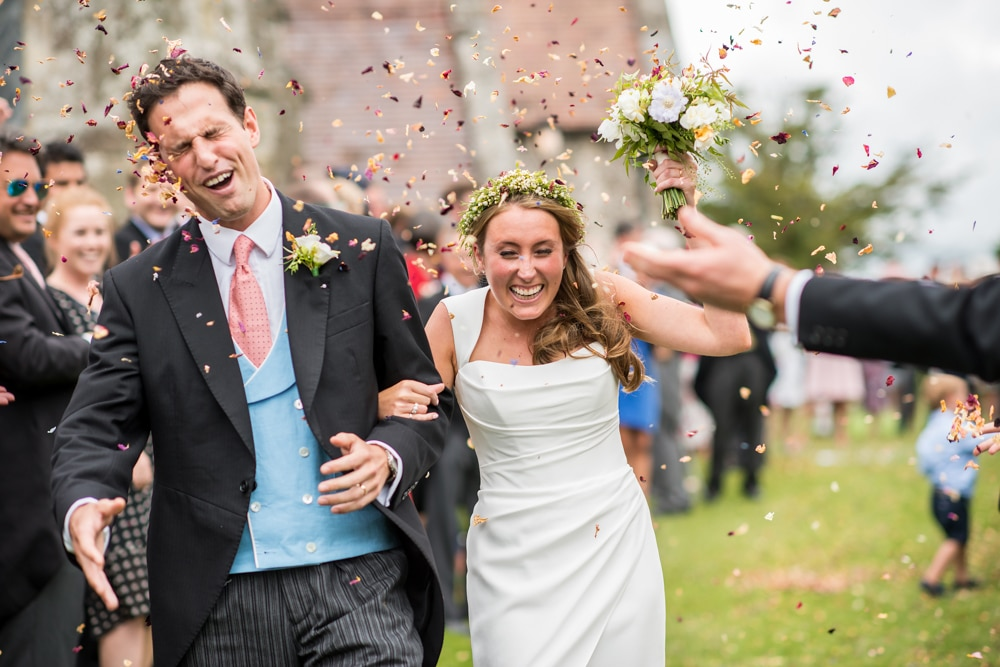 Confetti thrown at grooms face