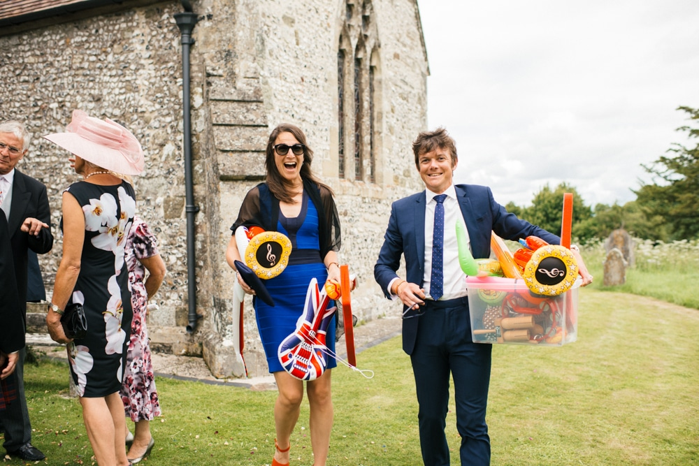 Guests holding inflatable musical instruments