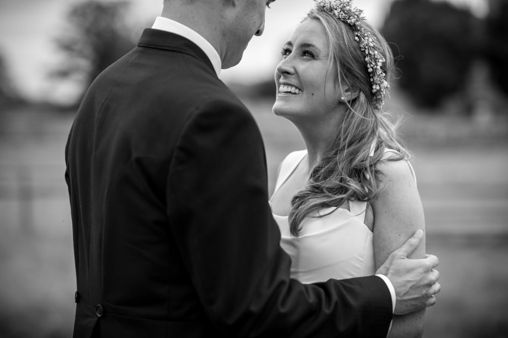 Close up portrait of bride looking at groom