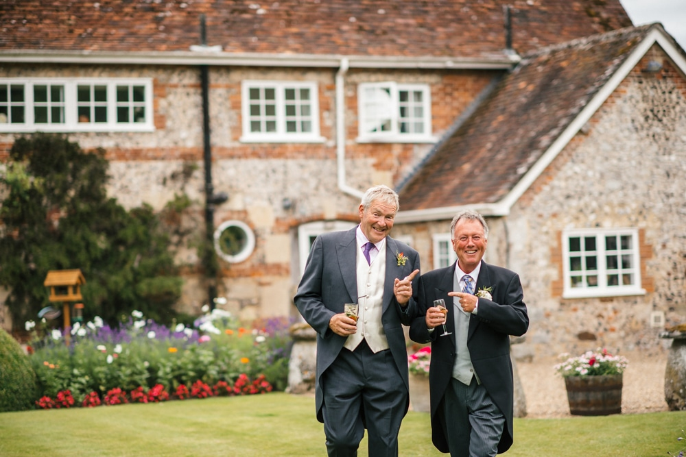 wedding reception in garden of New Forest House, father of the bride with his best man from back in the day
