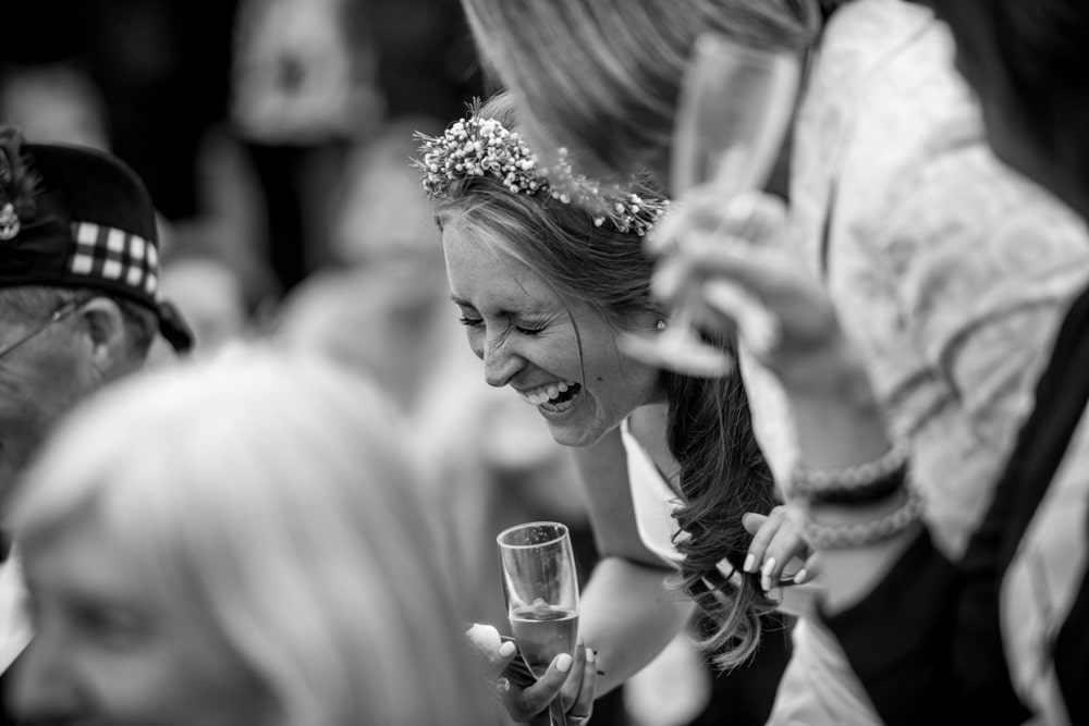 Bride laughing hard on her wedding day