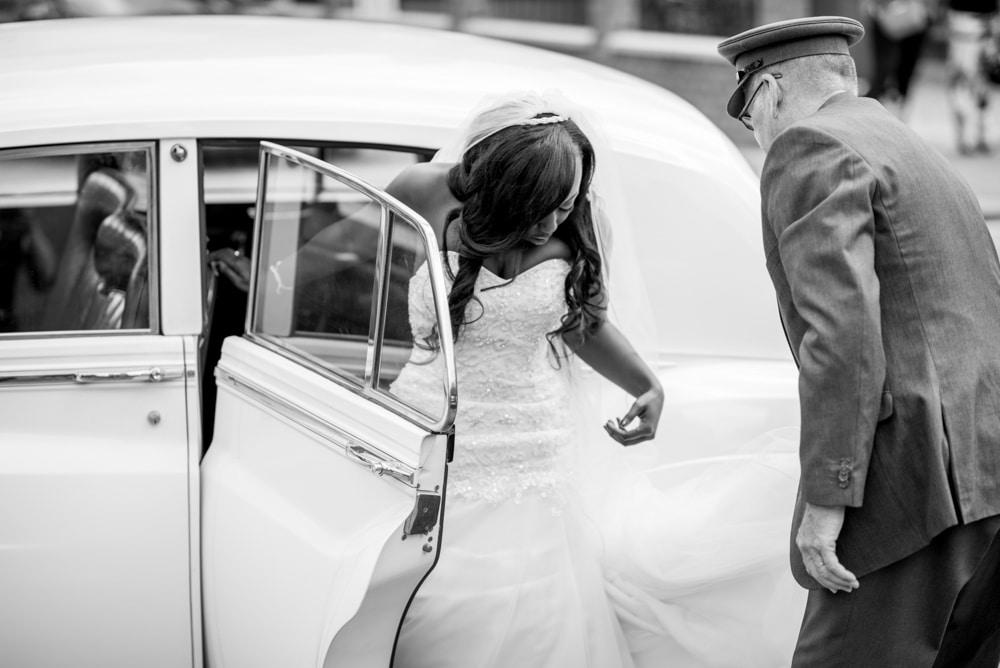 Bride exiting wedding car