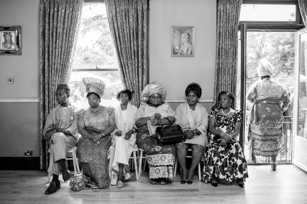 African Caribbean wedding, guests sitting on chairs