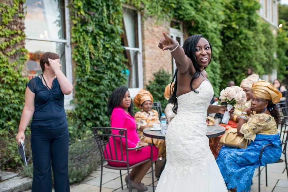Bride throwing wedding bouquet at High Elms Manor Watford