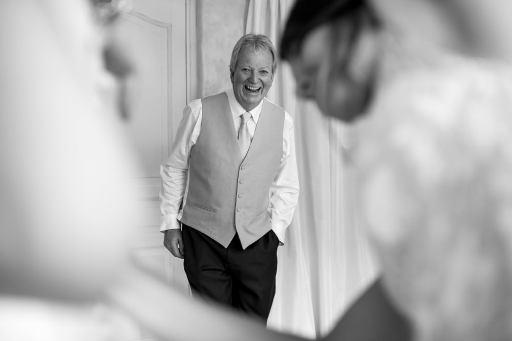 father of the bride happy and laughing