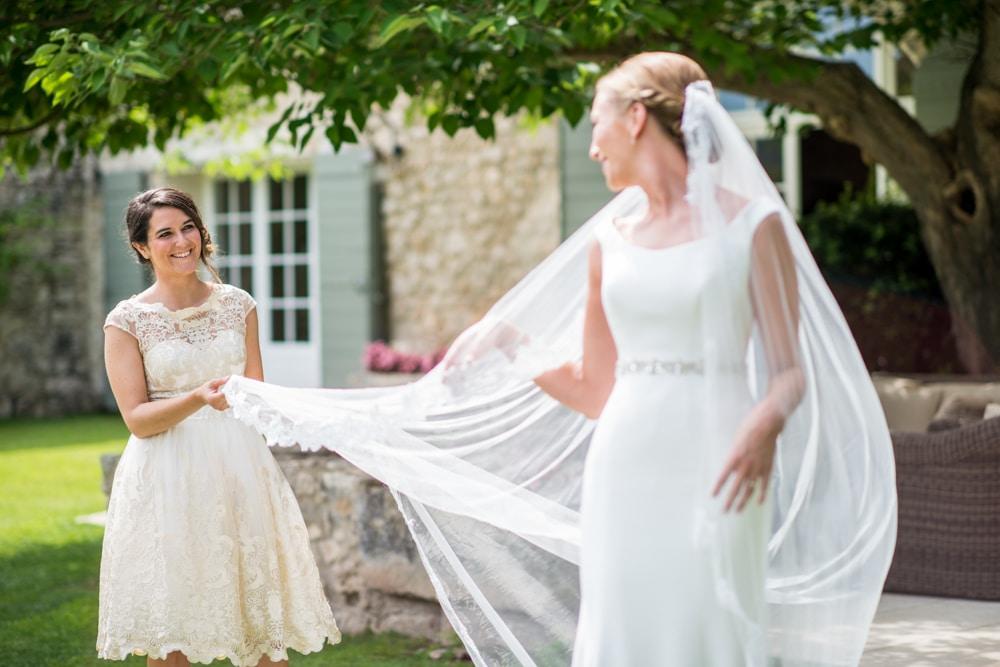bridesmaid holding wedding veil