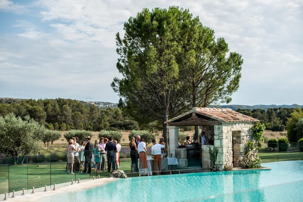 reception around pool at Le Mas de La Rose wedding venue