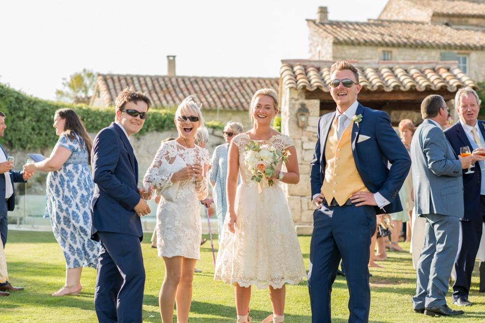 wedding guests smiling at Le Mas de La Rose wedding venue