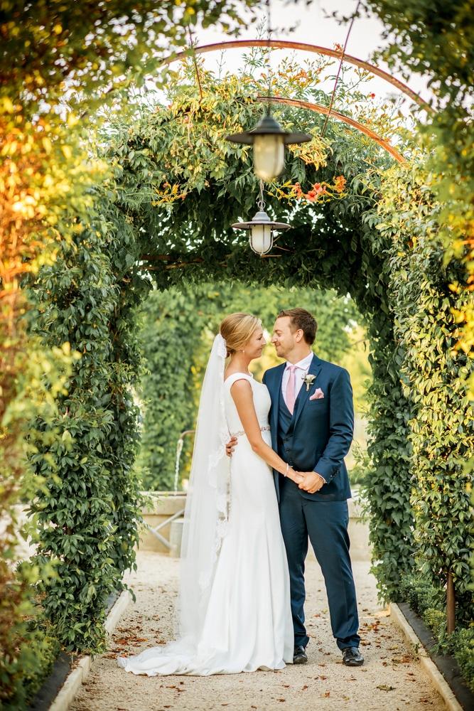 bride and groom in gardens at Le Mas de La Rose France