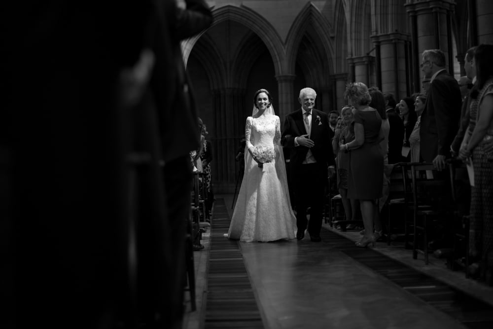 bride walking down the aisle at St james Church London