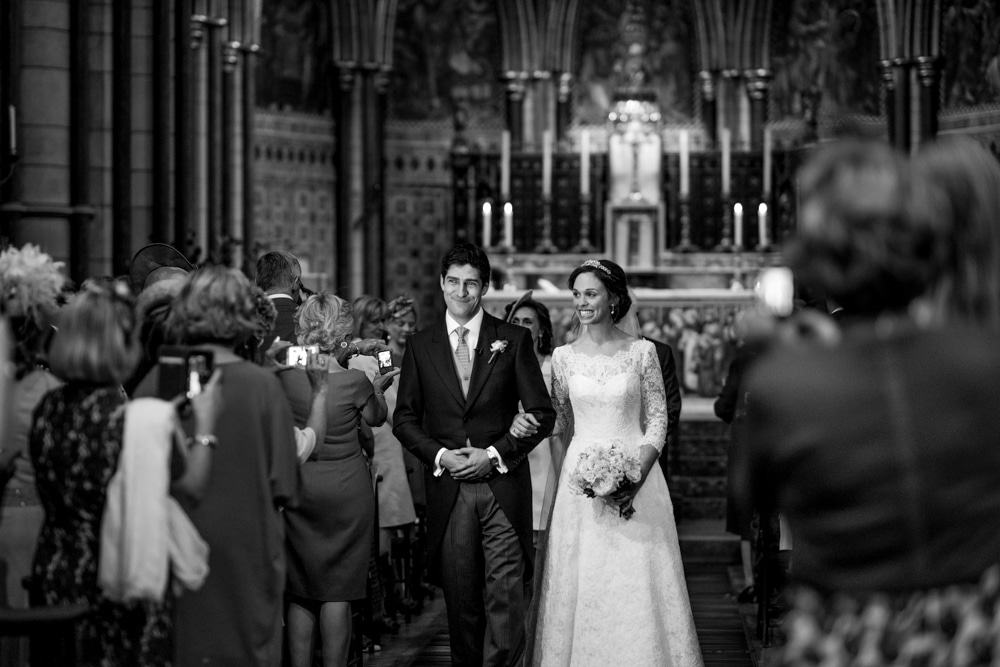 bride and groom walking down the aisle at St James church london wedding