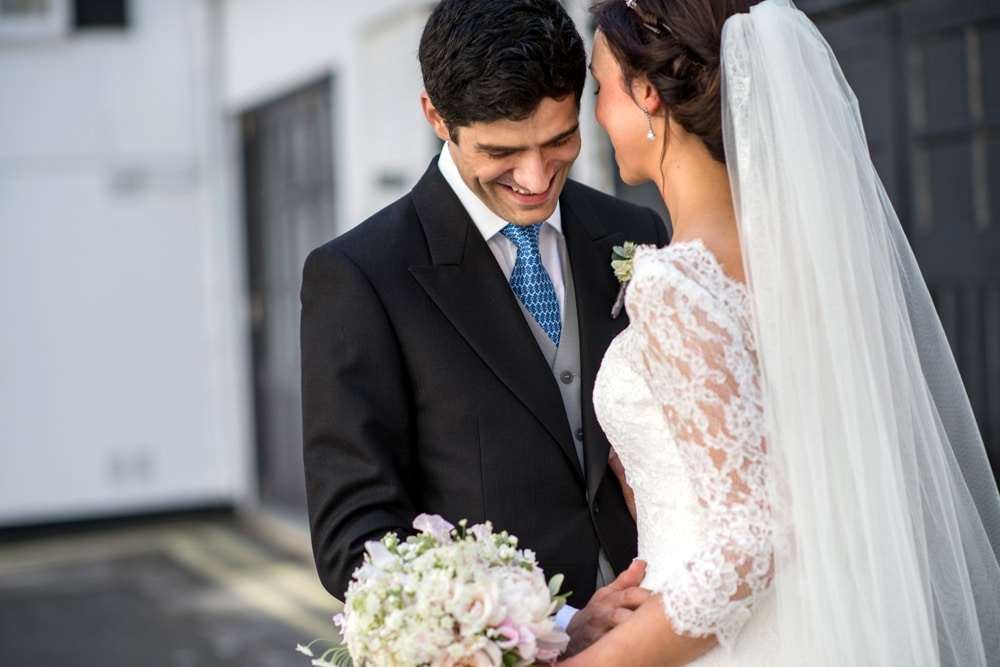portraits of bride and groom in London mews street