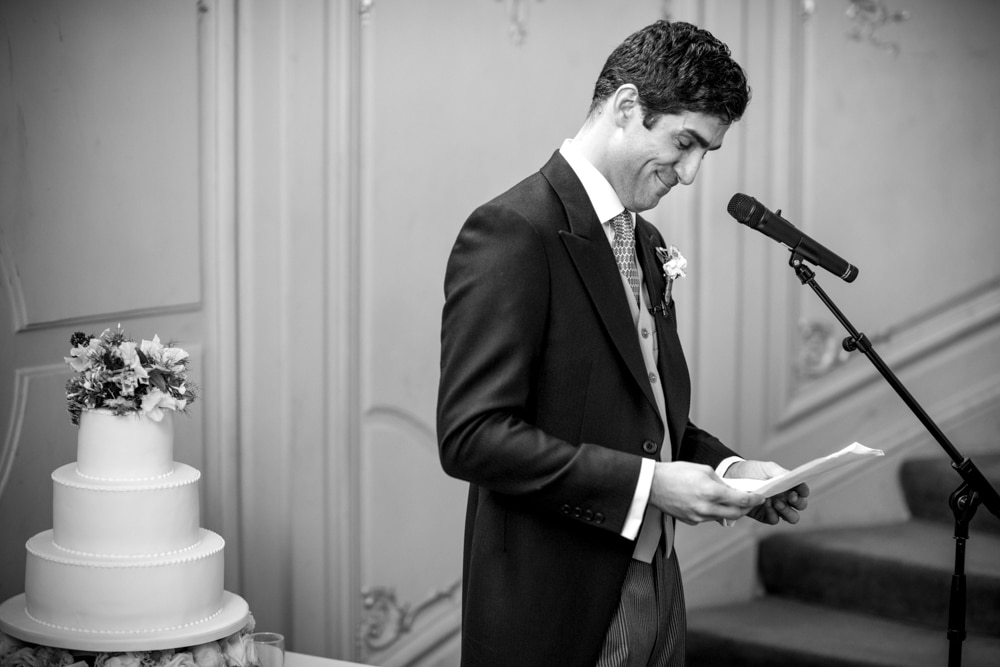 grooms speech on the stairs at the Savile Club London wedding