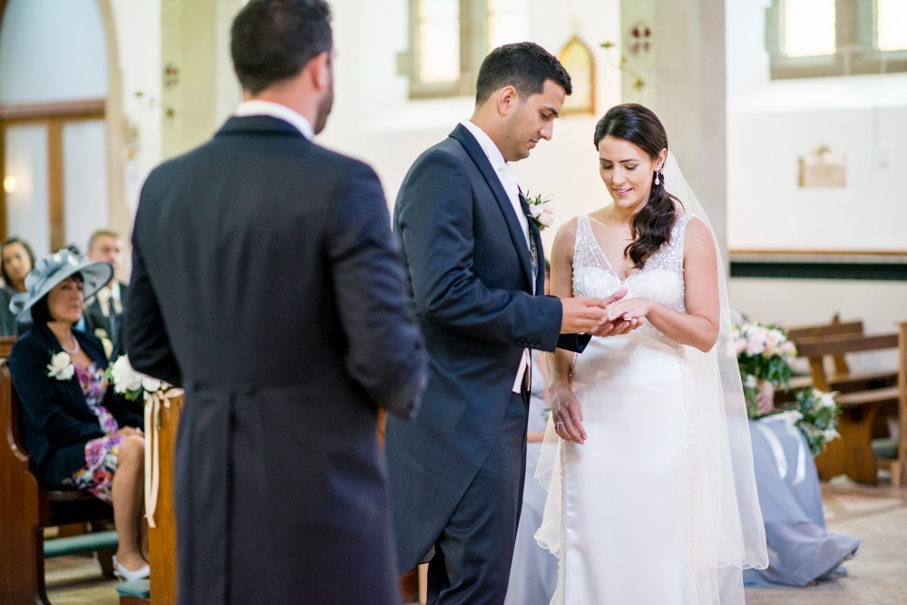 exchanging rings at St Francis of Assisi church