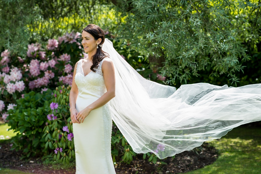 bridal portrait with veil blowing in wind