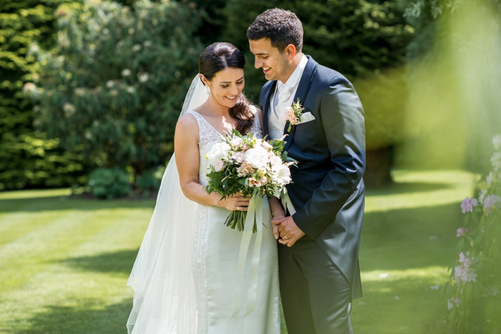 bride and groom portrait in beautiful garden