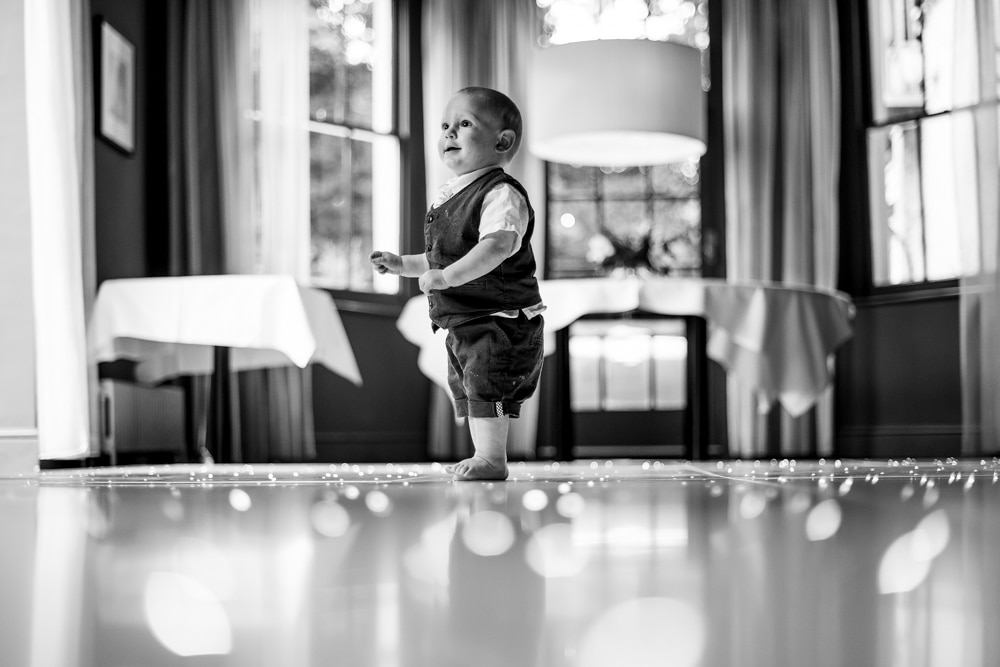 pageboy on dancefloor at bluebells restaurant wedding