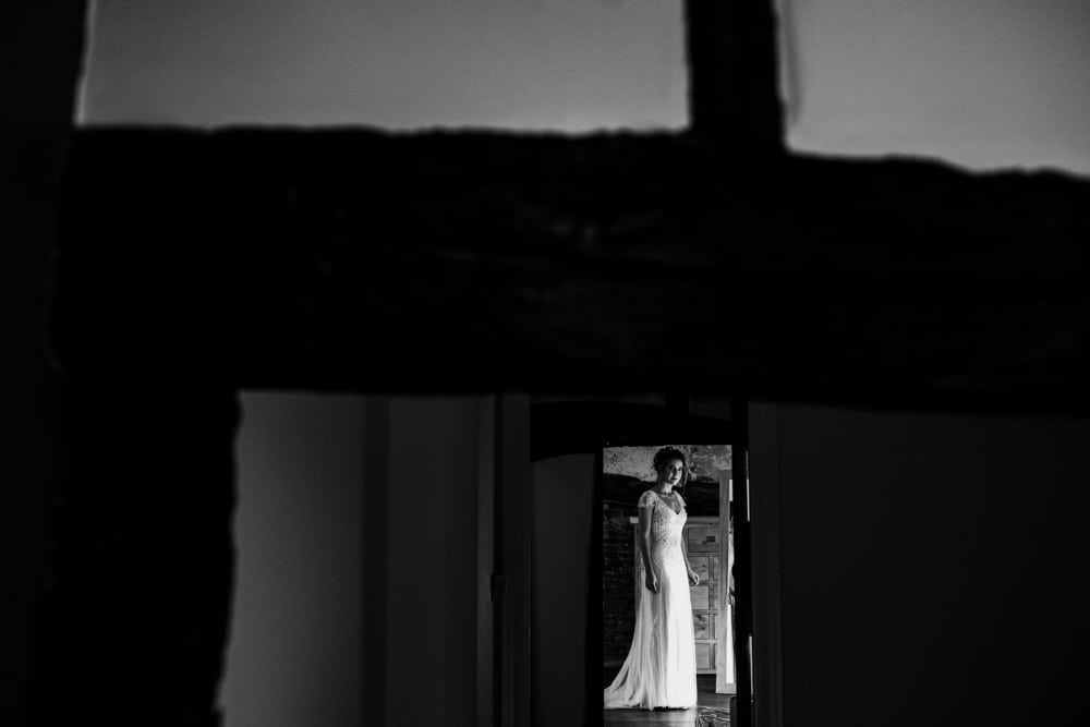 bride framed by timber doorway