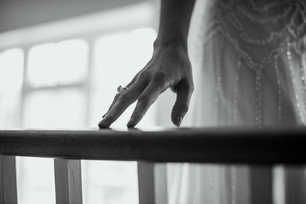 detail shot of brides hand on banister