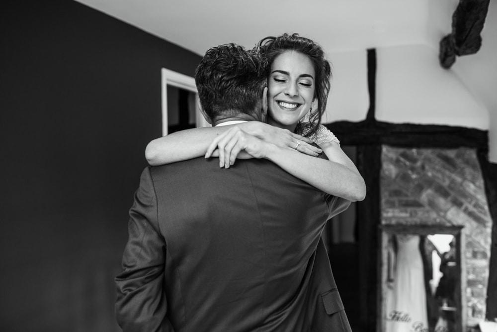 bride hugging daughter