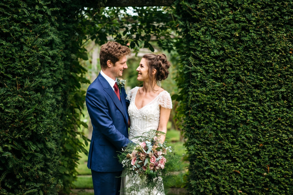 Bride and groom portraits at Micklefield Hall in the gardens
