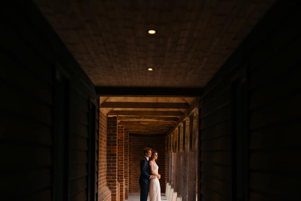bride and groom portraits framed by doors