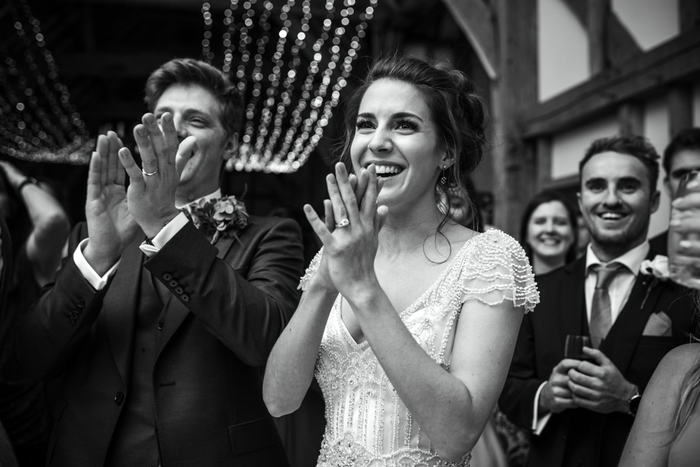 bride and groom clapping after speech