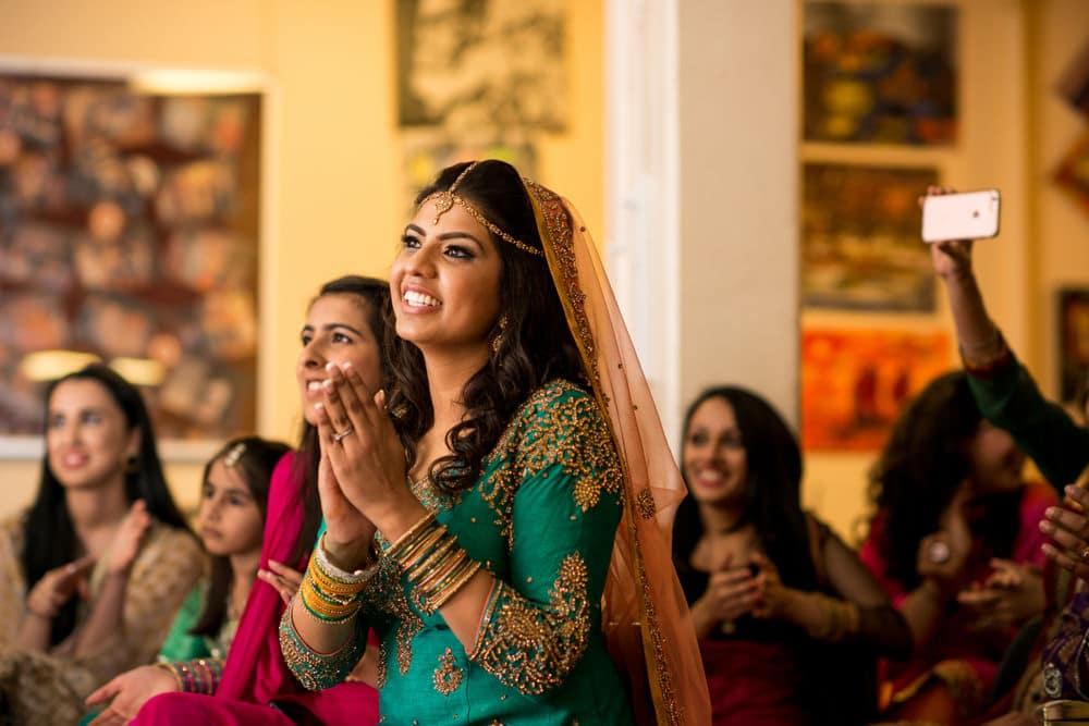 bride watching dancers at her Mehndi
