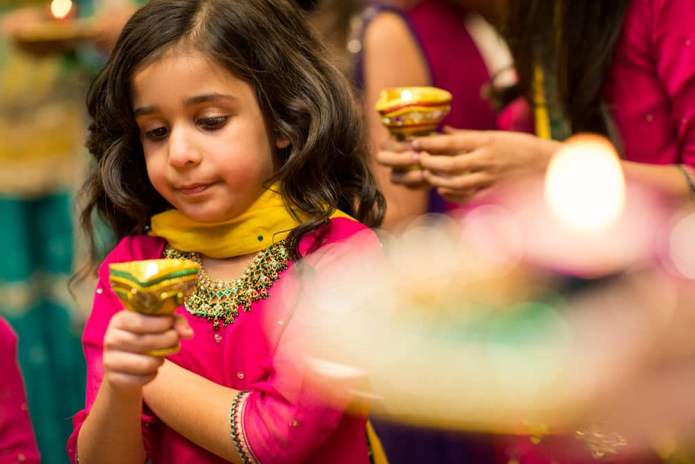 child holding candle at Mehndi