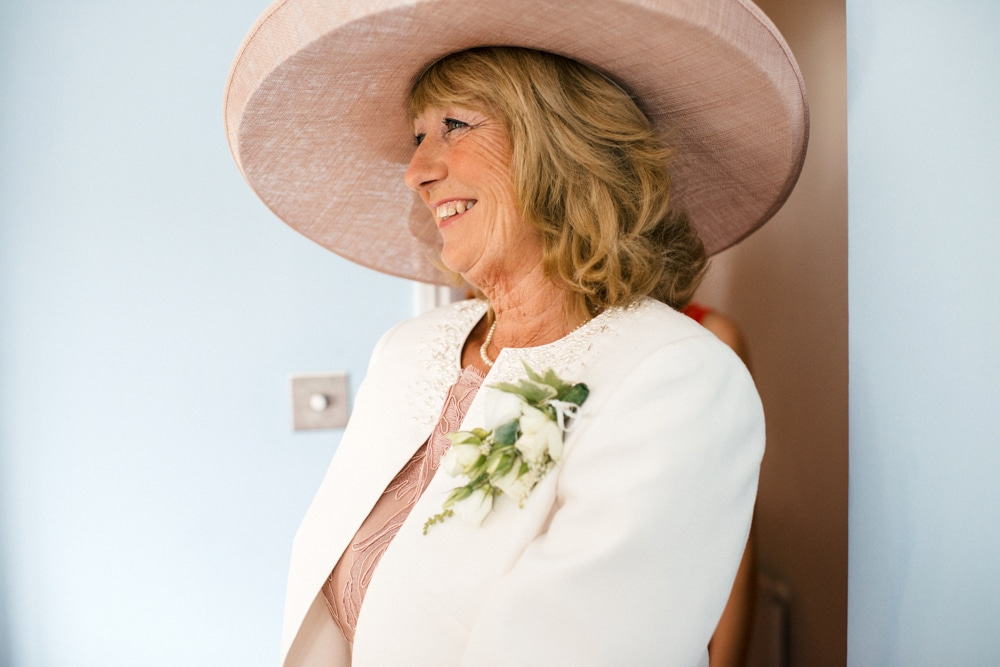 mother of bride in pink hat