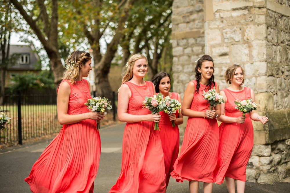 bridesmaids at church in pink dresses
