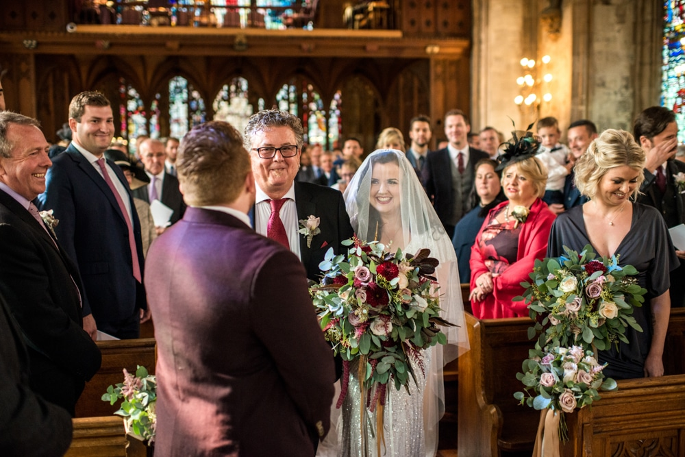 bride walking down the aisle with her father at st etheldreda's church