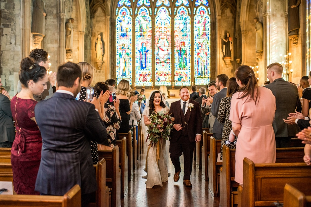 bride and groom walk down the aisle at st etheldreda's church