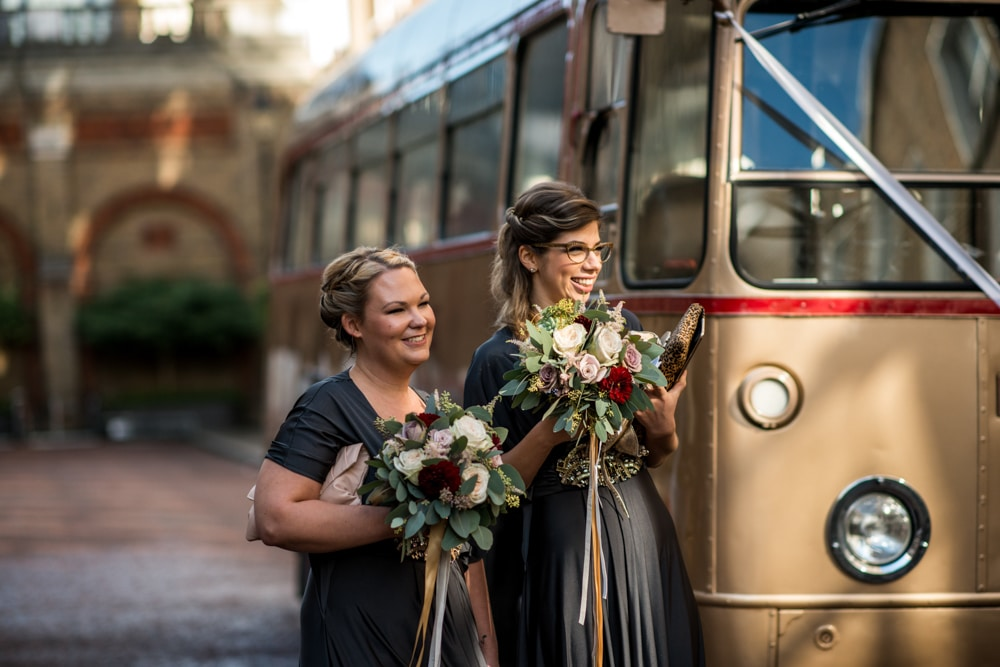 bridesmaids next to vintage gold wedding bus