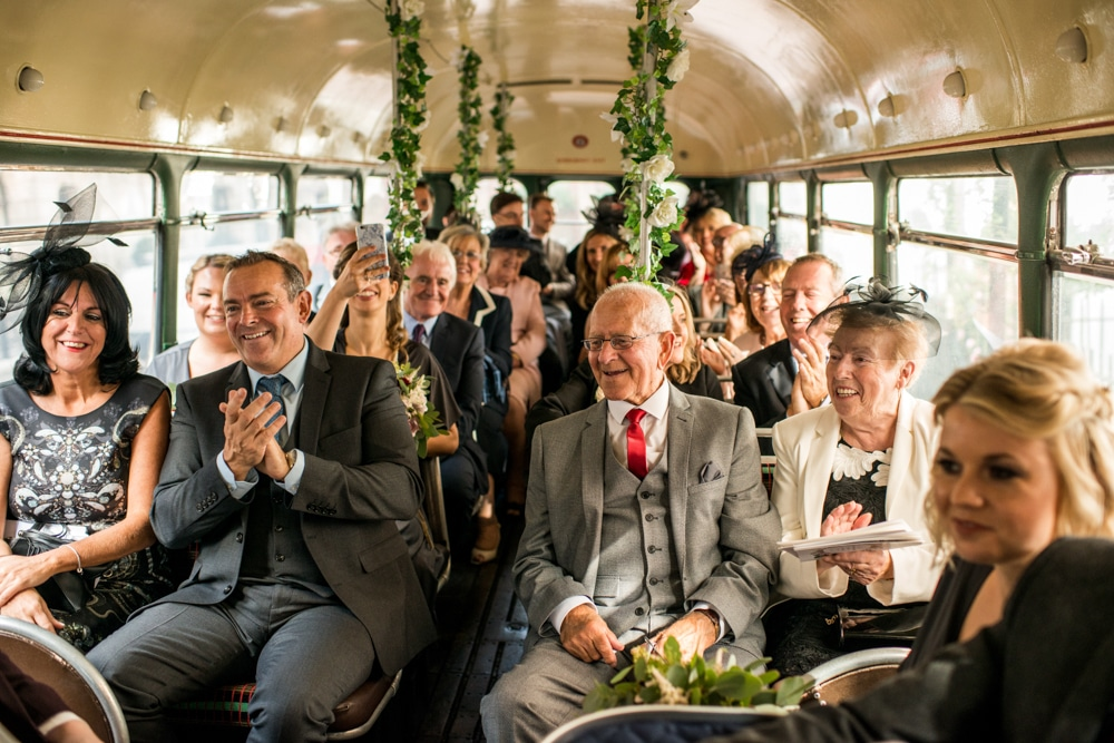 Guests inside vintage London wedding bus