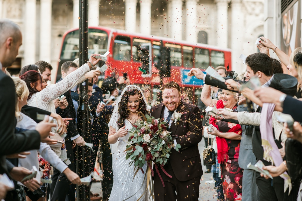 London confetti scene, red bus in background