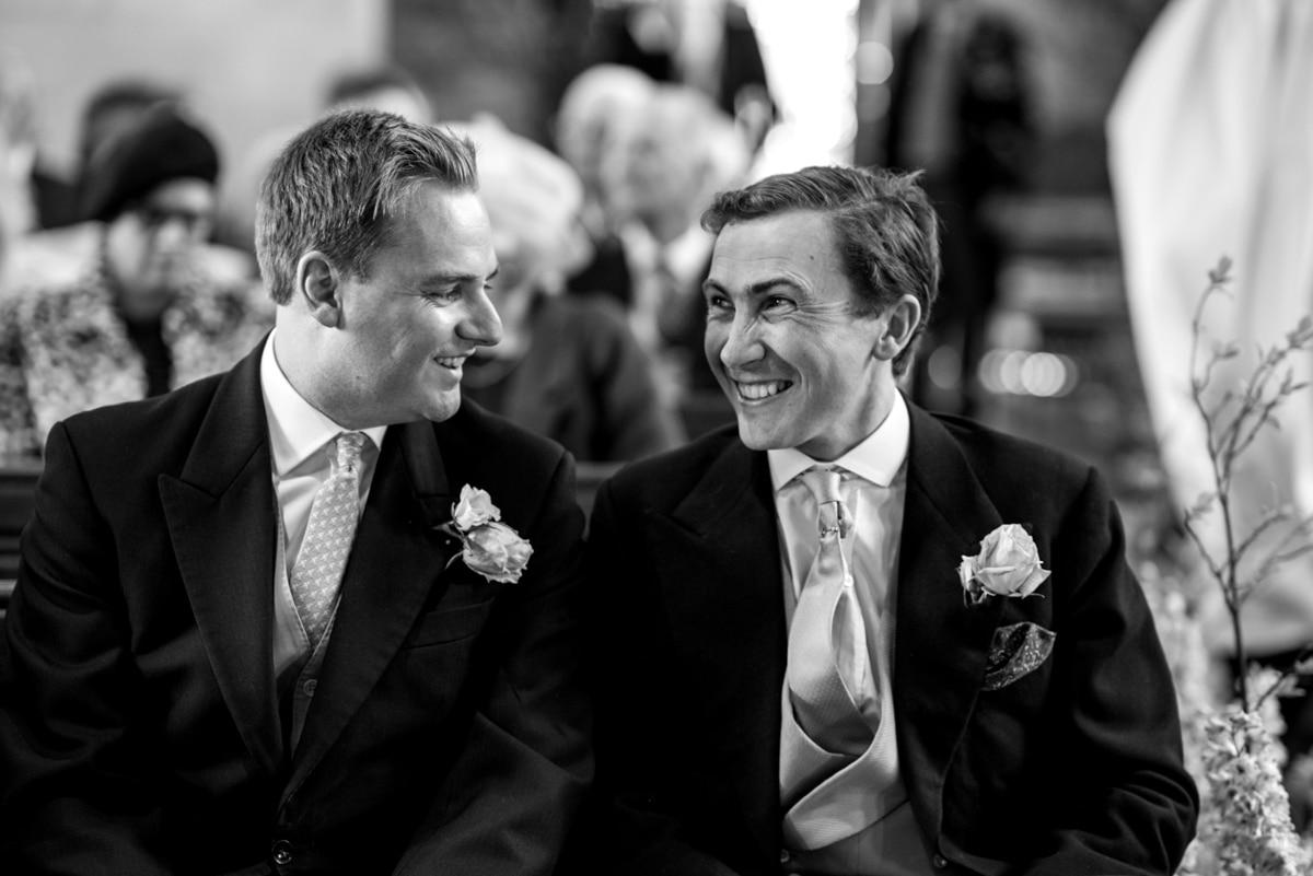 groom and bestsmen in church