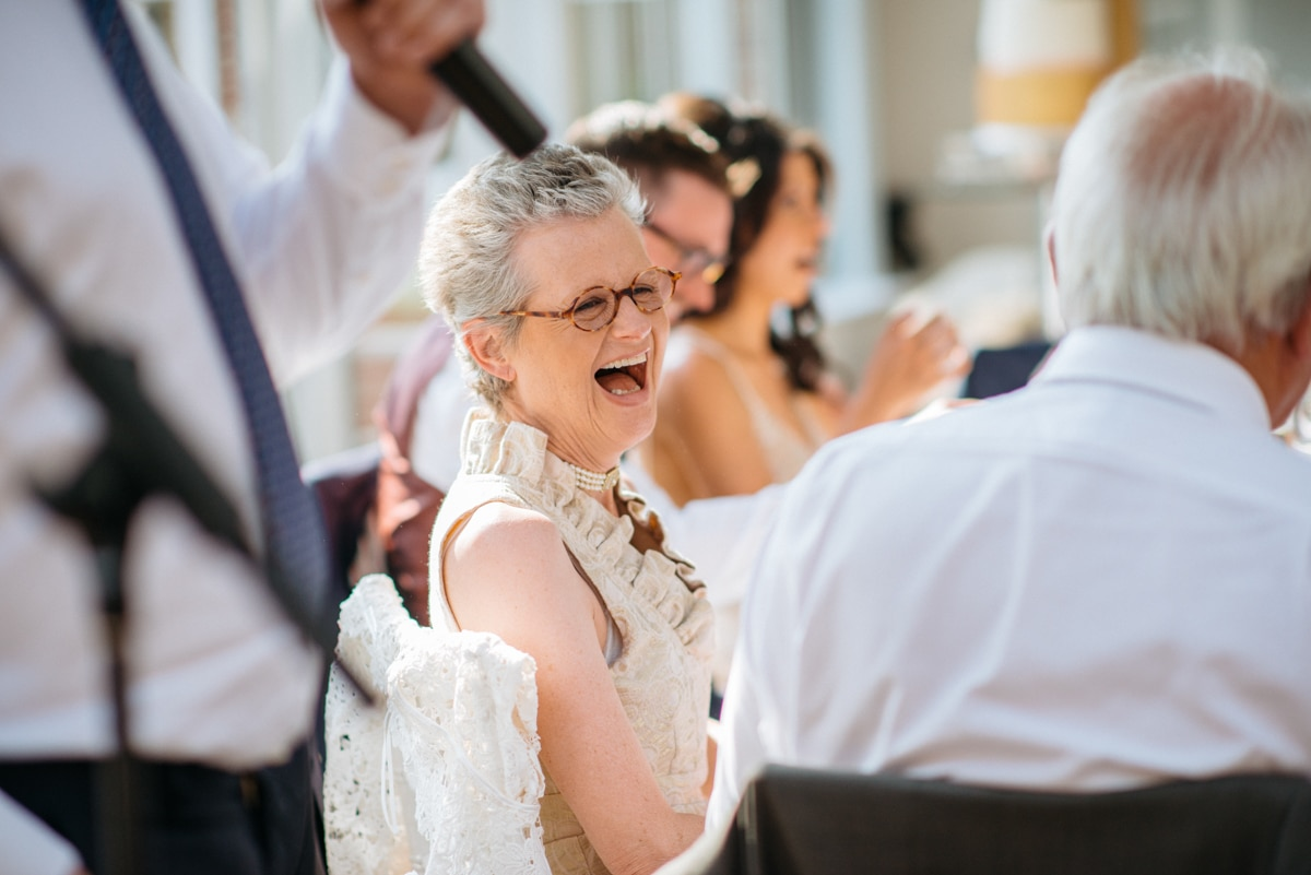 mother of groom laughing during the speeches