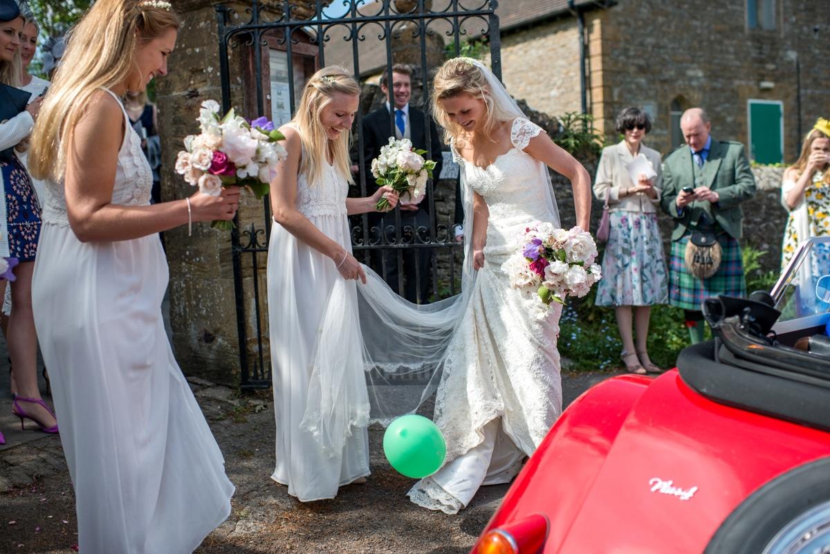 bride popping ballons, Dorset wedding