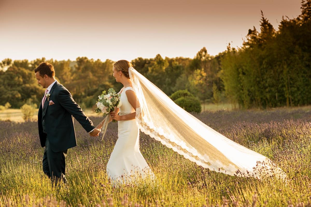 bride and groom in lavender field in France