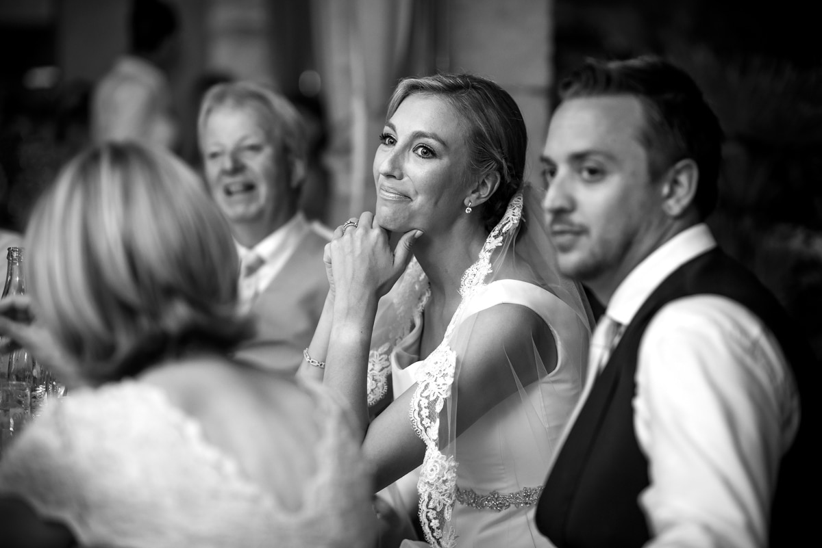 bride smiling during the speeches