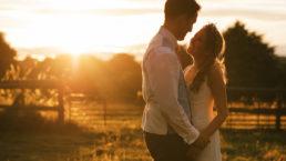 Golden light portrait of bride and groom in field, Dordet wedding photographer