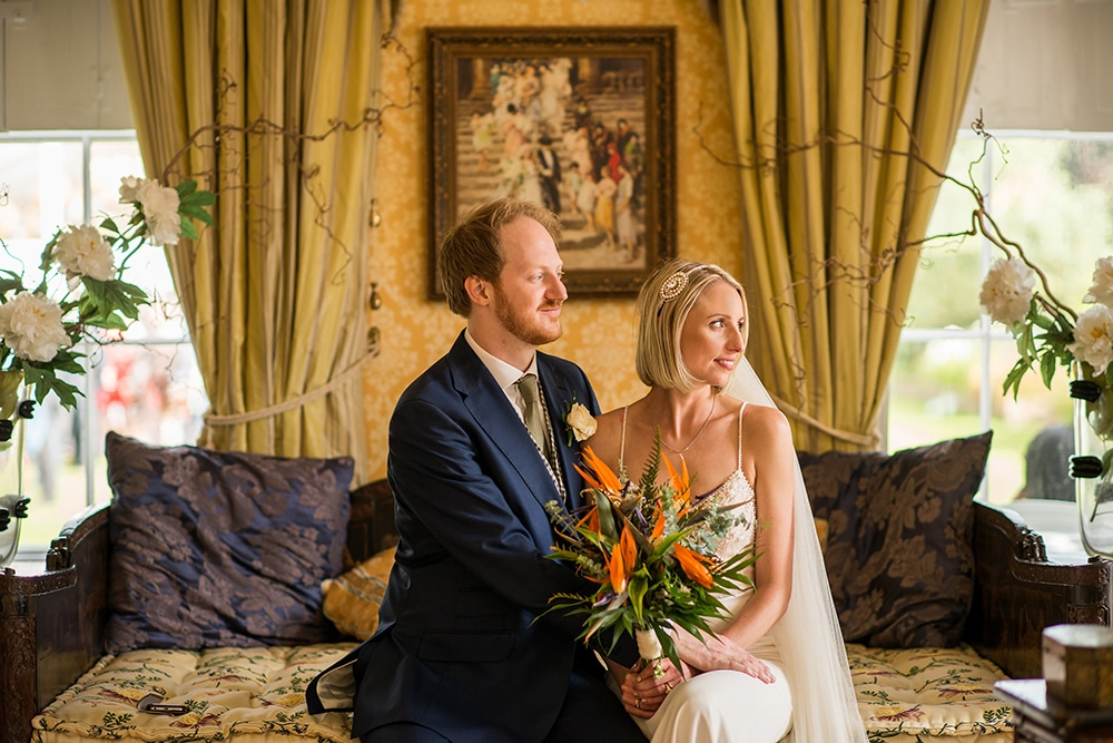 Interior portrait of couple at Worlingham Hall