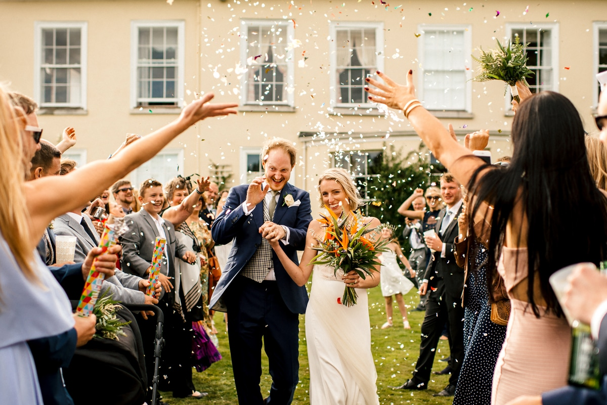 confetti moment with bride and groom