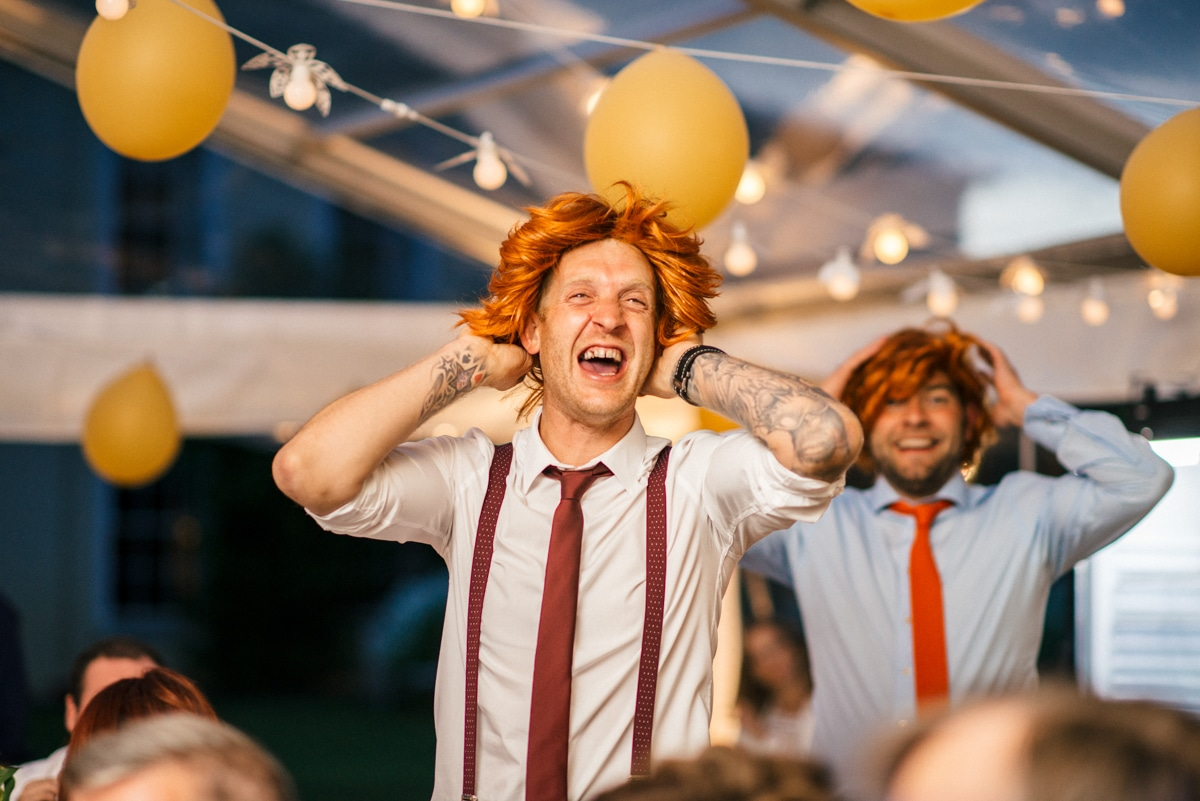 Wedding guests with ginger wigs on