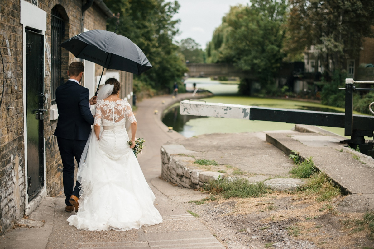 Bride and groom walking along canal London